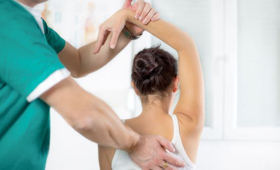 chiropractor working with patient upper body